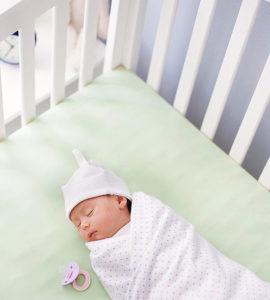 sleeping baby in crib
